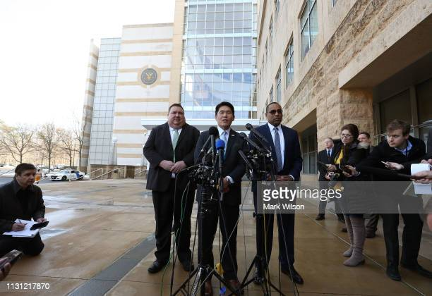 S Attorney Robert Hur speaks while flanked by FBI Special Agent Gordon Johnson and Art Walker of the Coast Guard Investigative Service after a...