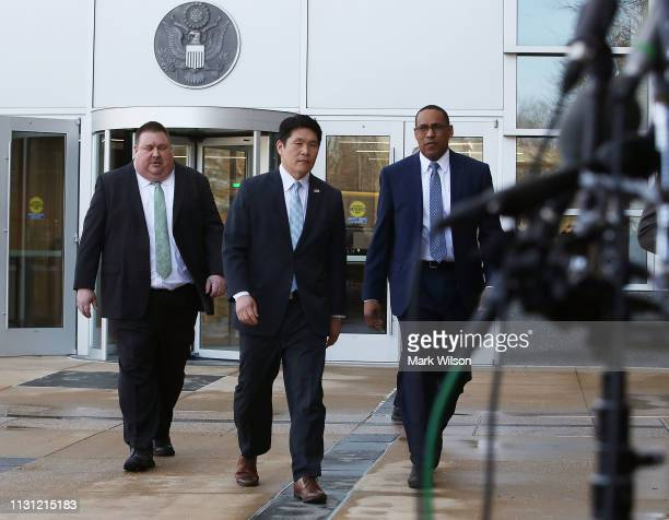 S Attorney Robert Hur walks up to speak to the media while flanked by FBI Special Agent Gordon Johnson and Art Walker of the Coast Guard...
