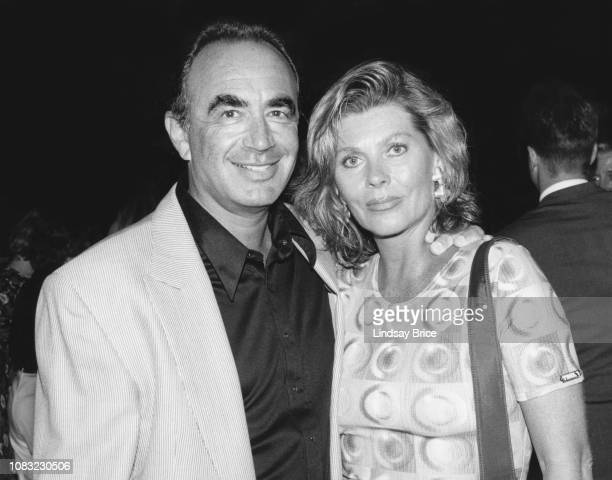 Attorney Robert Shapiro and Linell Shapiro pause for a photograph as they arrive for the ACLU premiere of the film Killer A Journal of Murder on July...