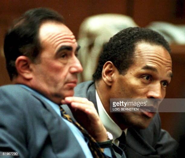 Attorney Robert Shapiro and O.J. Simpson listen as Simpson's friend Rosie Grier testifies 09 December 1994 during a hearing in the Simpson murder...