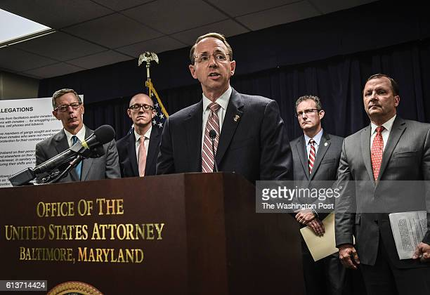 S Attorney Rod Rosenstein center during a press conference to announce Federal prosecutors indictments against 80 people for alleged racketeering and...