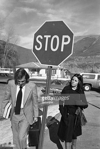 Attorney Ron Austin ducks around a stop sign as he walks to lunch with singer actress Claudine Longet Miss Longet is charged with felony manslaughter...