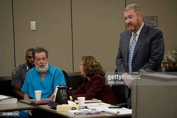Attorney Rose Roy center tries to quite client Robert Dear Jr during an outburst while attorney Daniel King argues on Dear's behalf in court on...