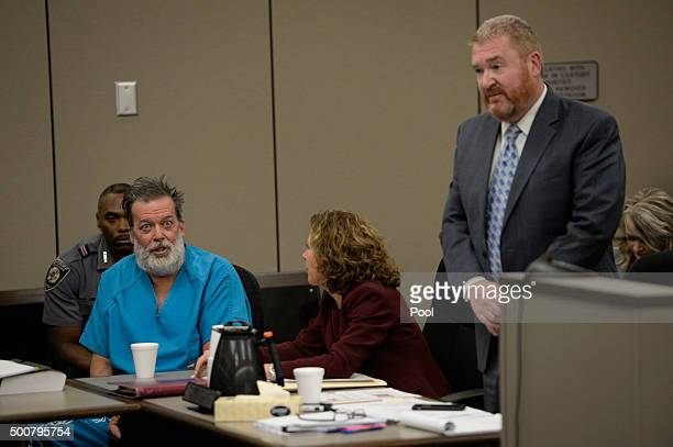 Attorney Rose Roy tries to quiet client Robert Lewis Dear during an outburst while attorney Daniel King argues on Dear's behalf in court December 09...