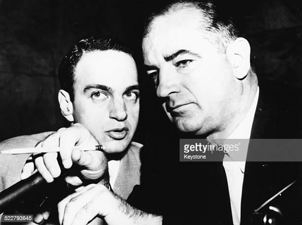 Attorney Roy Cohn talking to American senator Joseph McCarthy , circa 1954.