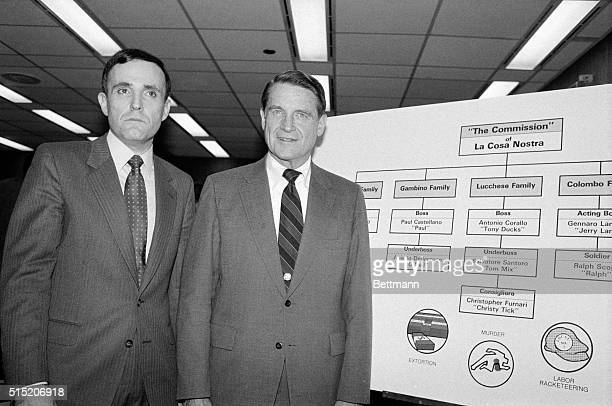 """Attorney Rudolph Giuliani and FBI Director William Webster look at chart of """"The Commission"""" of La Cosa Nostra during press conference at which..."""