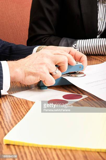 Attorney Sealing a Legal Document