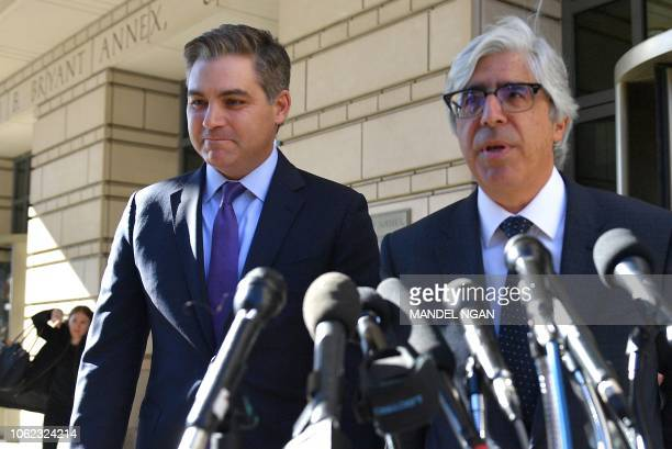 CNN attorney Ted Boutrous with CNN White House correspondent Jim Acosta speaks outside US District Court in Washington DC on November 16 2018 Judge...
