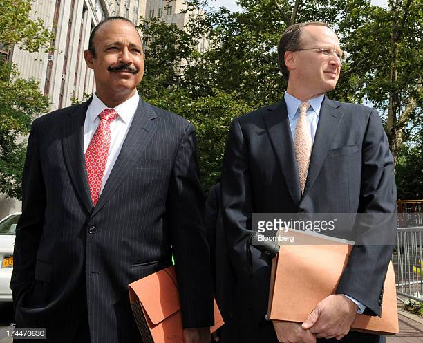 Attorney Ted Wells left and Peter Nussbaum general counsel for SAC Capital Advisors LP walk outside federal court in New York US on Friday July 26...