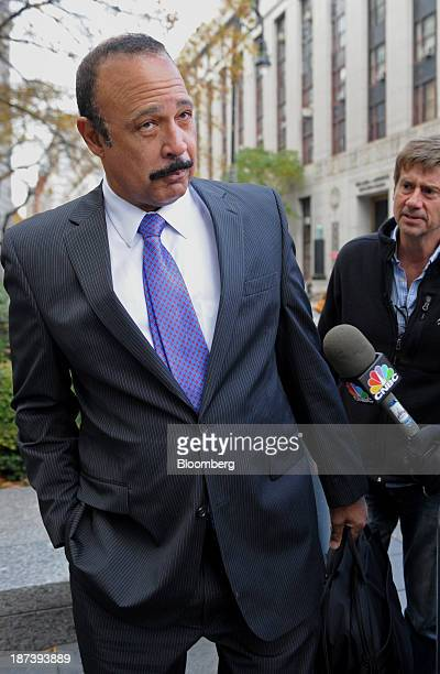 Attorney Ted Wells left speaks to the media before entering federal court in New York US on Friday Nov 8 2013 SAC Capital Advisors LP will plead...