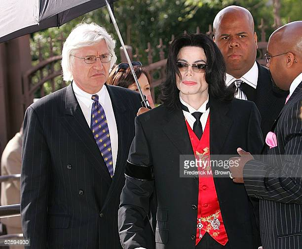Attorney Thomas Mesereau Jr and singer Michael Jackson arrive to the funeral services for lawyer Johnnie L Cochran Jr at the West Angeles Cathedral...