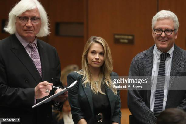 Attorney Thomas Mesereau model Dani Mathers and attorney Dana M Cole stand during court proceedings for a hearing at Clara Shortridge Foltz Criminal...