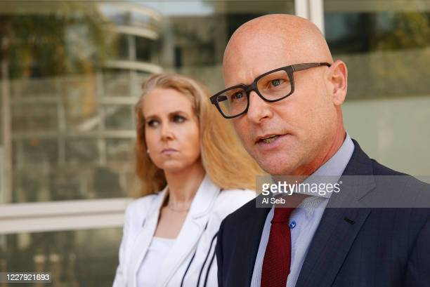 Attorneys Darren Kavinoky, and Jennifer McGrath represent nearly 100 victims of UCLA Gynecologist Dr. James Heaps talk to media after Heaps is taken...