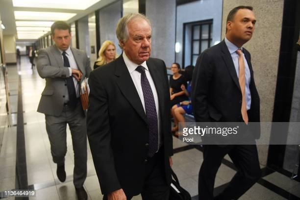 Attorneys Jack Goldberger Alex Spiro and William Burck the defense team for New England Patriots owner Robert Kraft make their way to Courtroom 2E at...