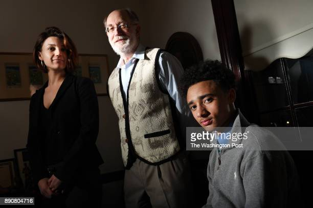 Attorneys Maxwelle Sokol left and Victor M Glasberg pose for a portrait with client Eric Trammel at Glasberg's law office on Tuesday December 05 2017...