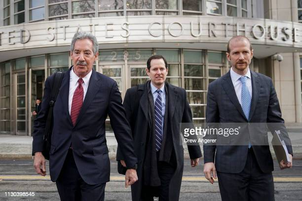 Attorneys representing Huawei Technologies Co James Cole Michael Levy and David Bitkower depart the US District Court for the Eastern District of New...