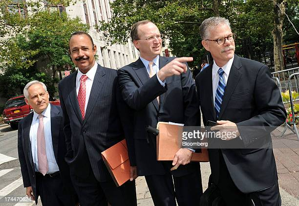 Attorneys representing SAC Capital Advisors LP from left Michael Gertzman Ted Wells Peter Nussbaum general counsel for SAC and Daniel J Kramer walk...