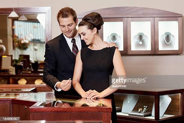 Attracitve Young Couple Admiring Diamond Wedding Rings