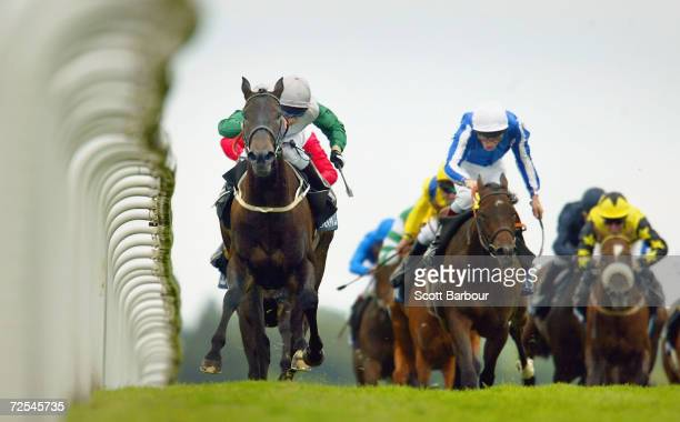 Attraction ridden by K Darley wins race 3, The Coronation Stakes during the fourth day of Royal Ascot at the Ascot Racecourse on June 18, 2004 in...