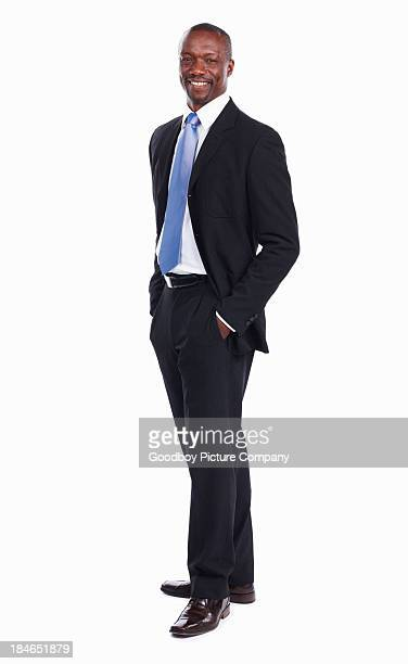 attractive african american business man smiling - hands in pockets stock pictures, royalty-free photos & images