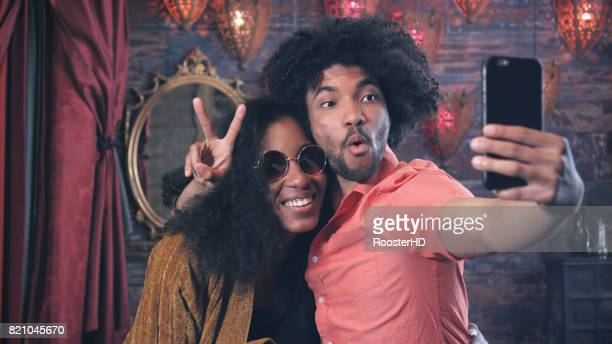 Attractive African American Couple take Selfie with Peace Sign