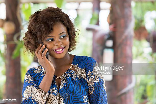 Attractive African woman on mobile phone, smiling
