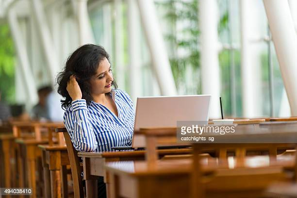 Attractive Asian Business Woman Working Away From Office