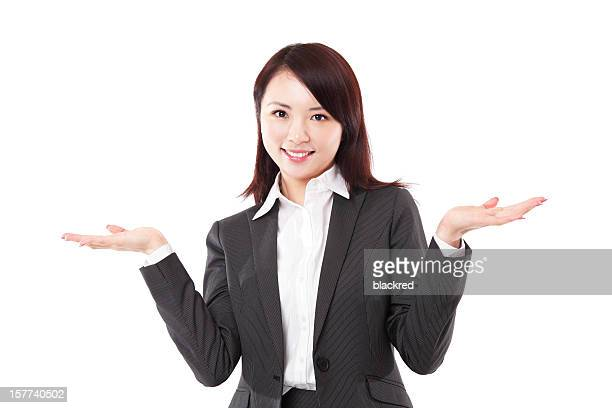 Attractive Asian Businesswoman Palms Up on White Background