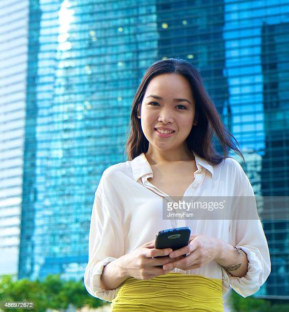 Attractive Asian woman with mobile phone