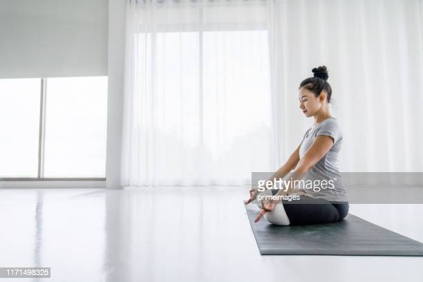 attractive asian women do yoga exercises at home - daily life in philippines stock pictures, royalty-free photos & images