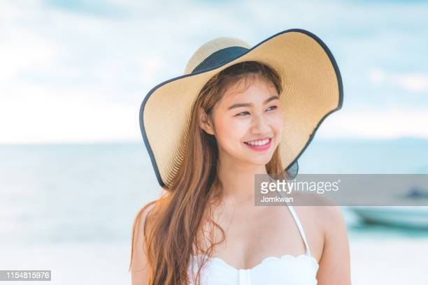 attractive asian young woman wearing white
