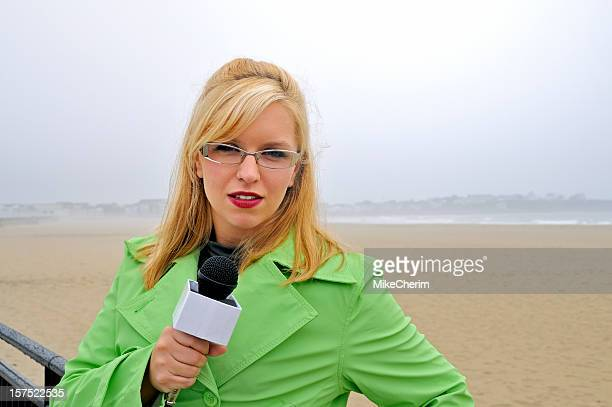 Attractive Beach Reporter on Location