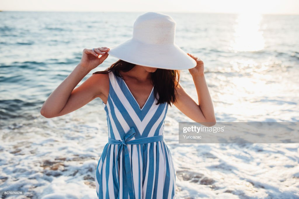 Attractive Beautiful Woman With White Hat On Head On Sea