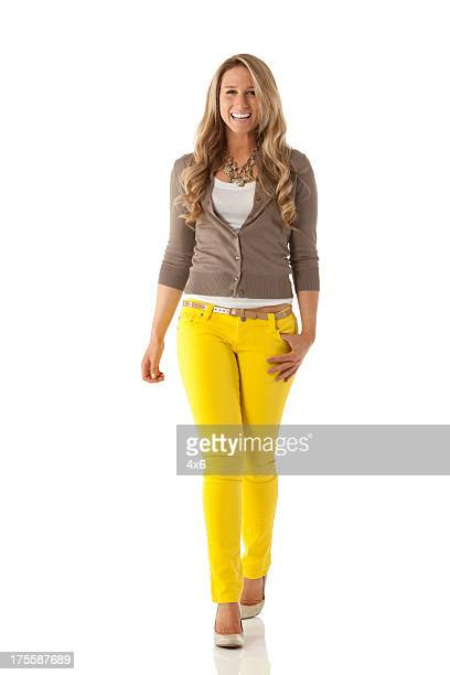 attractive beautiful young woman smiling - yellow trousers stock pictures, royalty-free photos & images