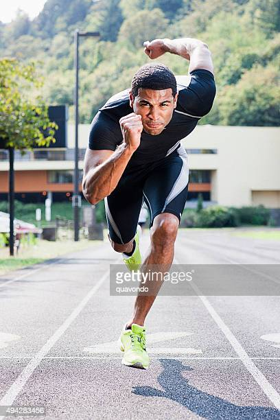 Attractive Black Track Athlete Running On Track