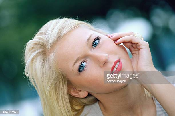 attraktiv blond teenager outdoor portrait - embarrassment stock photos and pictures