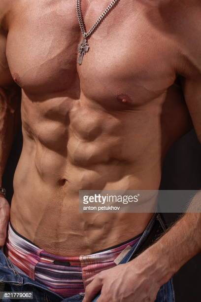 attractive body of young man - chippendales photos et images de collection