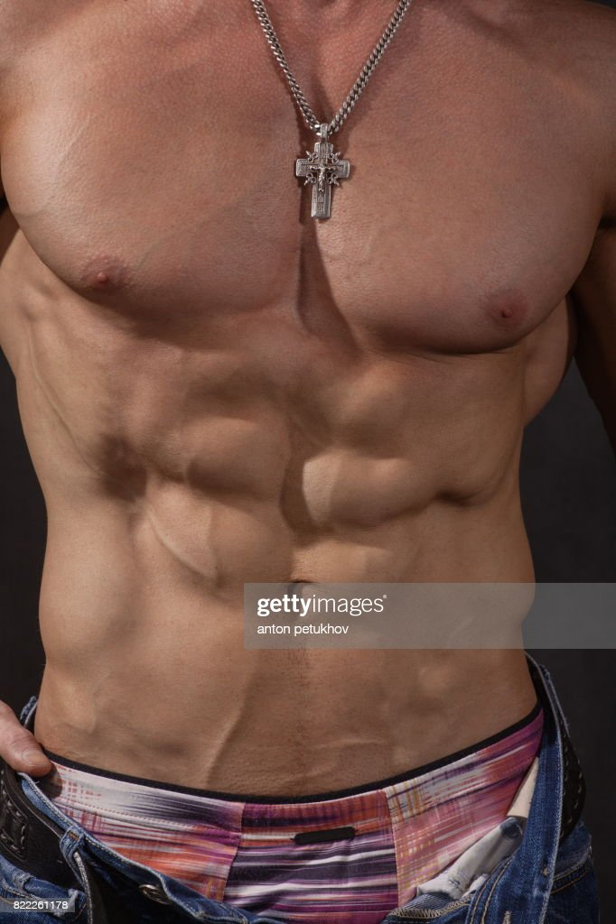 Attractive body of young man : Stock Photo