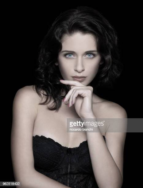 attractive brunette woman looks with her big blue eyes - vogue stock pictures, royalty-free photos & images