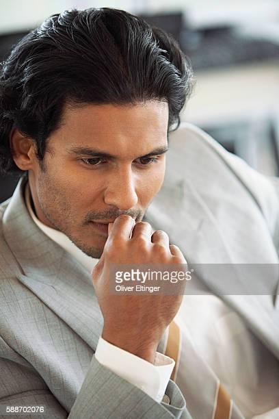 attractive businessman looking serious - oliver eltinger stock-fotos und bilder