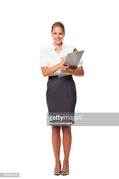 Attractive Businesswoman Holding A Clipboard. Isolated