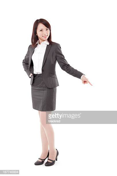 Attractive Businesswoman Pointing Down on White Background