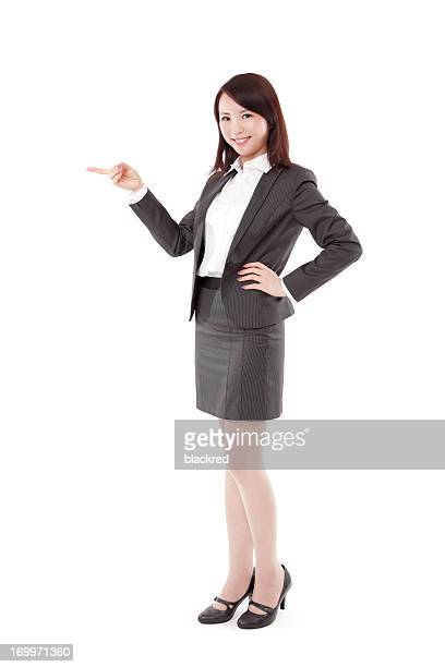 Attractive Businesswoman Pointing on White Background
