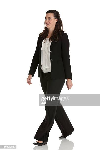 Attractive businesswoman walking