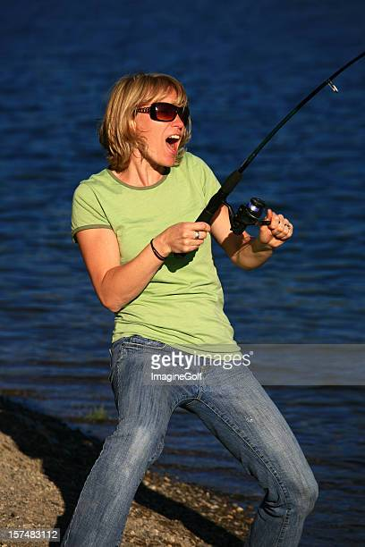 Attractive Caucasian Woman Catching a Fish