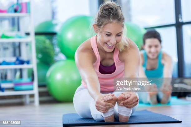 Attractive Caucasian woman stretches before workout