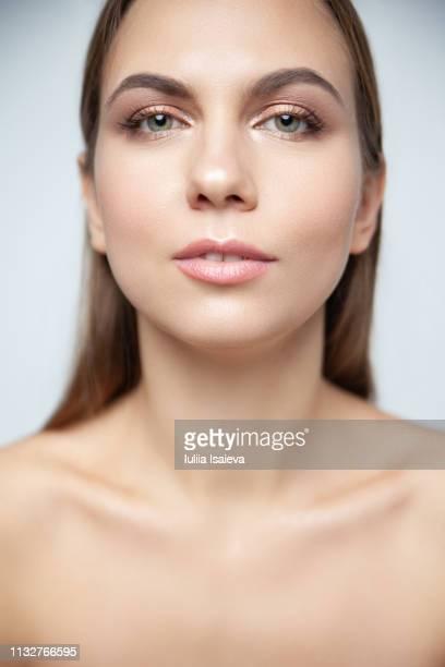 attractive charming woman with naked shoulders - vogue fotografías e imágenes de stock