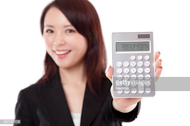 Attractive Chinese Businesswoman Holding a Calculator Smiling on White Background