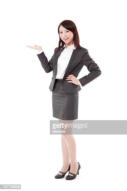 Attractive Chinese Businesswoman Presenting on White Background