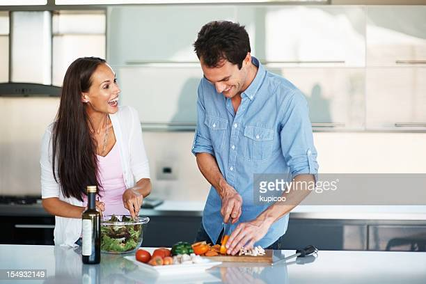 Attractive couple having fun in the kitchen